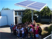 Kids and solar panel.